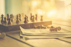 Chess pieces on dollar bills